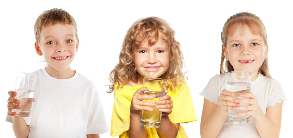 kids drinking pure distilled water